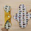 Compresa de tela lavable eco BICICLETAS-MOSTAZA